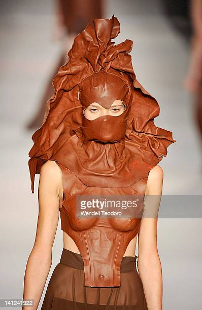 Model showcases a design by Laura Huishan Li during the National Graduate showcase on day six of the 2012 L'Oreal Melbourne Fashion Festival on March...