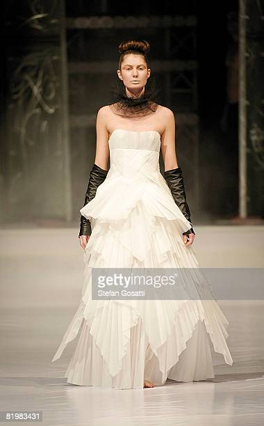 Model showcases a design by Leanne Lim, Stockman Paper dress, on the catwalk during the StyleAid Perth Fashion Event 2008 at the Burswood...