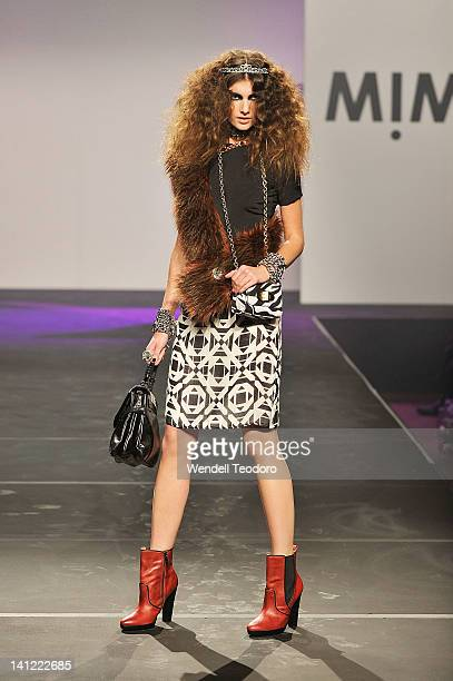A model showcases a design by Mimco on day six of the 2012 L'Oreal Melbourne Fashion Festival on March 13 2012 in Melbourne Australia