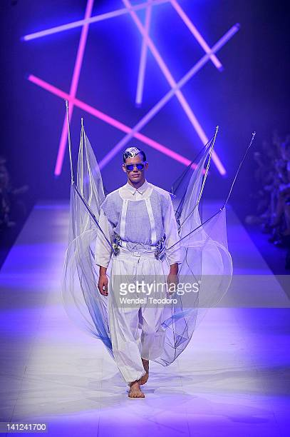 Model showcases a design by Tayler Ainley during the National Graduate showcase on day six of the 2012 L'Oreal Melbourne Fashion Festival on March...
