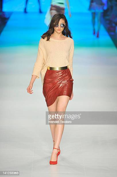 A model showcases a design by White Suede during the L'Oreal Paris runway 5 show on day six of the 2012 L'Oreal Melbourne Fashion Festival on March...