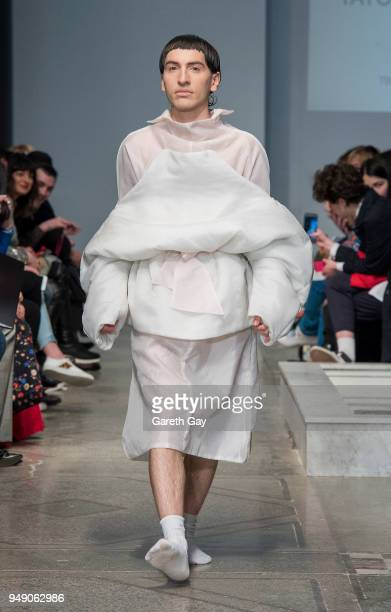 A model showcases a design on the runway during the new talent competition show at the Tbilisi Balneolical Resort during Tbilisi Fashion Week on...