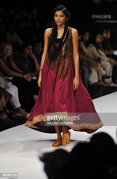 Model showcases a dress by Indian designer Myoho on the fourth day of Lakme Fashion Week 2010 in Mumbai on March 8, 2010. The bi-annual LFW is in its...