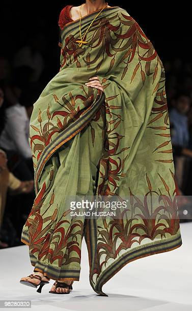 A model showcases a saree by Indian designer Sashikant Naidu on the fourth day of Lakme Fashion Week 2010 in Mumbai on March 8 2010 The biannual LFW...