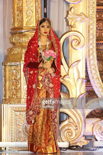 Model showcases an elegant bridal sari during the Amrapali 2018 fashion exhibition held in Markham Ontario Canada on March 11 2018