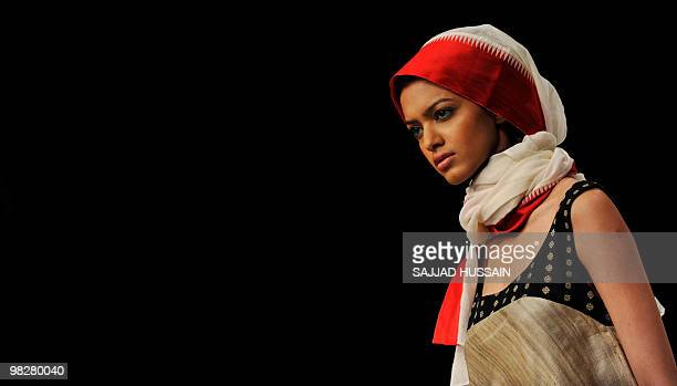 Model showcases an outfit by Indian designer Paromita Banerjee on the fourth day of Lakme Fashion Week 2010 in Mumbai on March 8, 2010. The bi-annual...