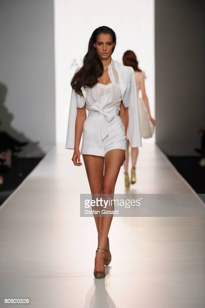 A model showcases an outift by designer Alex Perry on the catwalk during the second day of the Rosemount Australian Fashion Week Spring/Summer...