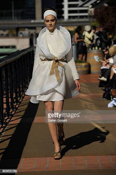 A model showcases an outift by designer Jayson Brunsdon on the catwalk during the fifth day of the Rosemount Australian Fashion Week Spring/Summer...