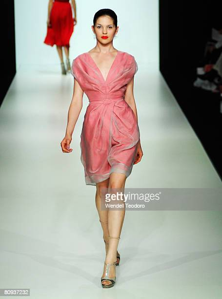 Model showcases an outift by designer Melanie Cutfield on the catwalk on the third day of the Rosemount Australian Fashion Week Spring/Summer 2008/09...