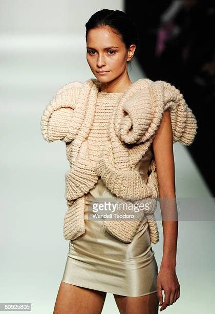 A model showcases an outift by designer Sandra Backlund on the catwalk on the third day of the Rosemount Australian Fashion Week Spring/Summer...
