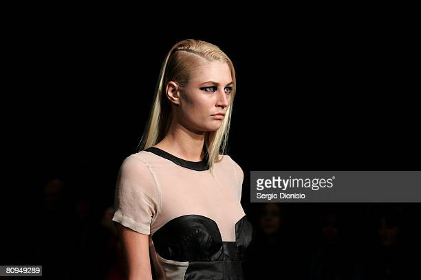 Model showcases an outift by designer Shakuhaci on the catwalk during the fourth day of the Rosemount Australian Fashion Week Spring/Summer 2008/09...