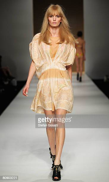 A model showcases an outift by designer Zimmermann on the catwalk during the second day of the Rosemount Australian Fashion Week Spring/Summer...