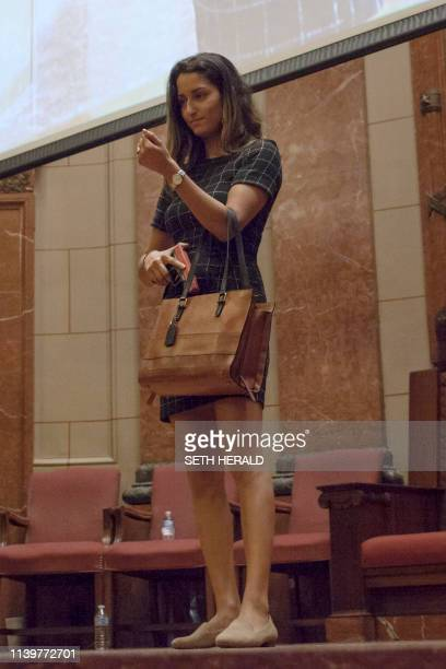A model showcases concealed fashion wear during a fashion show at the Indiana World War Memorial in Indianapolis Indiana on April 272019 after the...
