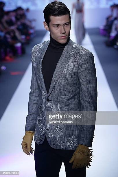 A model showcases design by Ashley Isham during the Audi Fashion Festival on day two at Tent at Orchard on May 15 2014 in Singapore