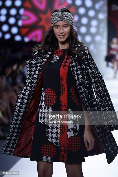 A model showcases design by Desigual during the Audi Fashion Festival on day two at Tent at Orchard on May 15 2014 in Singapore