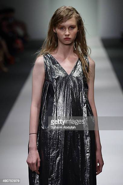 A model showcases design by Saturday during the Audi Fashion Festival on day two at Tent at Orchard on May 15 2014 in Singapore