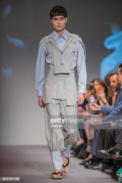 Model showcases design Extrication by Tommy Chong during the Visceral Instinct show by Raffles Hong Kong as part of the Fashion Week for Spring /...