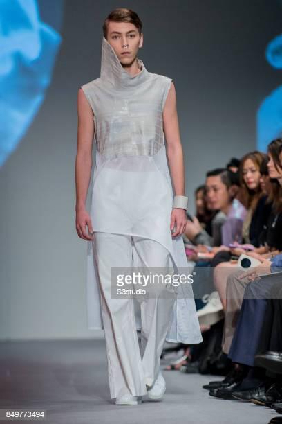 Model showcases design La Soif de L´Amor L´Éternité by Rickyy Wong during the Visceral Instinct show by Raffles Hong Kong as part of the Fashion Week...