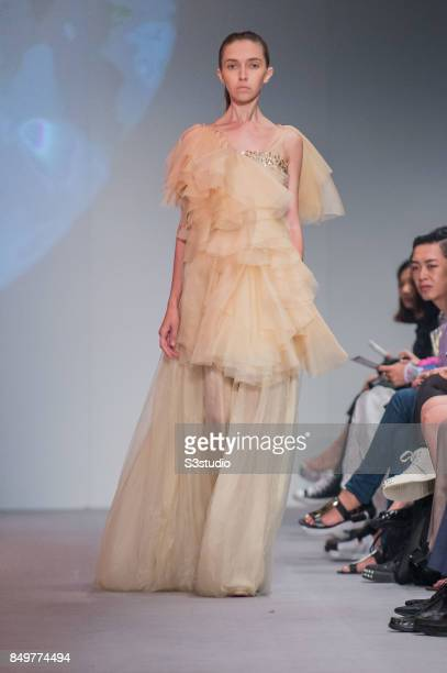 Model showcases design Marie Van Goethem by Grace CY Lam during the Visceral Instinct show by Raffles Hong Kong as part of the Fashion Week for...