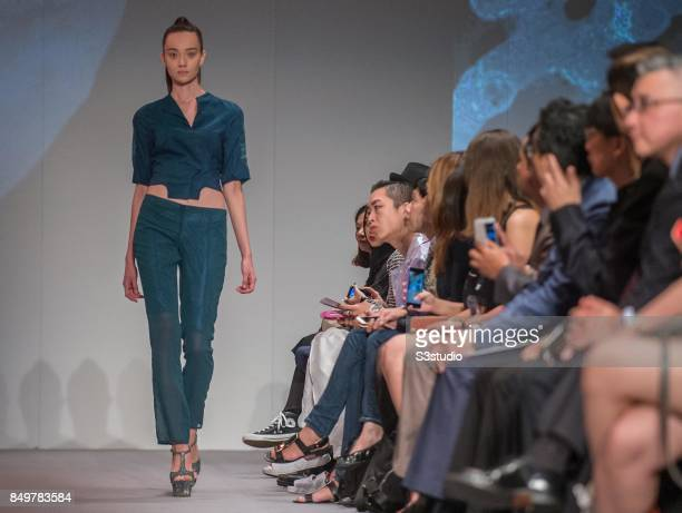 Model showcases design Trapped In The Multiverses by Chu Tin Lok Tina during the Visceral Instinct show by Raffles Hong Kong as part of the Fashion...
