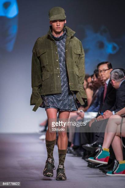 Model showcases design TThe Great Kim by 8 CUFF during the Visceral Instinct show by Raffles Hong Kong as part of the Fashion Week for Spring /...