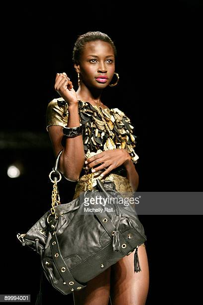 A model showcases a design from Luella by David Tlale at the Arise Cape Town Fashion Week held at the Cape Town International Convention Centre on...
