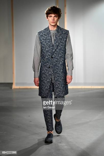 A model showcases designs at the BODYBOUND presentation during the London Fashion Week Men's June 2017 collections on June 9 2017 in London England