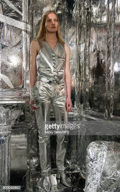 A model showcases designs at the MM6 Maison Margiela during London Fashion Week February 2018 at The Running Horse on February 18 2018 in London...