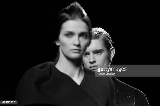 A model showcases designs by AA de Amaya Arzuaga on the runway at AA de Amaya Arzuaga show during Mercedes Benz Fashion Week Madrid Fall/Winter 2014...
