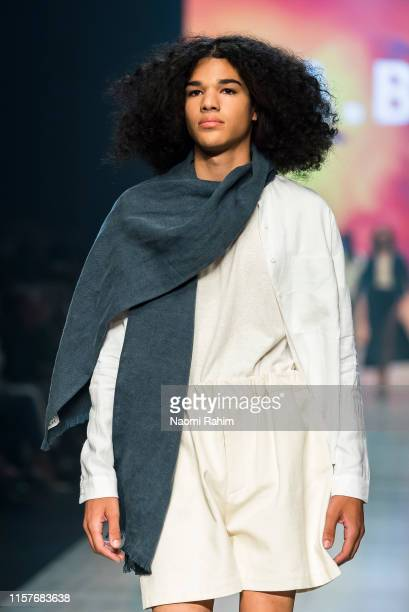 A model showcases designs by ABCH during Runway 6 at Melbourne Fashion Festival on March 9 2019 in Melbourne Australia