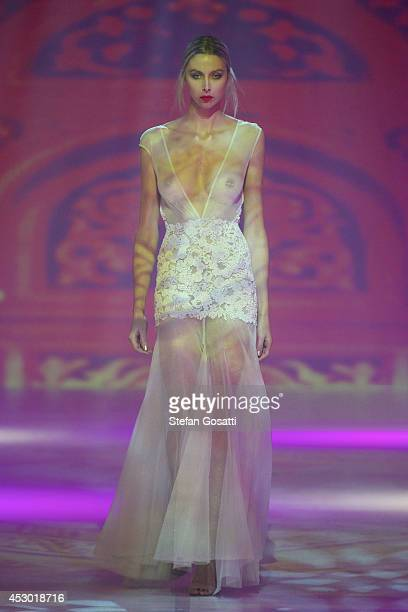 A model showcases designs by Ae'lkemi on the catwalk during Styleaid Mythic at Crown on August 1 2014 in Perth Australia