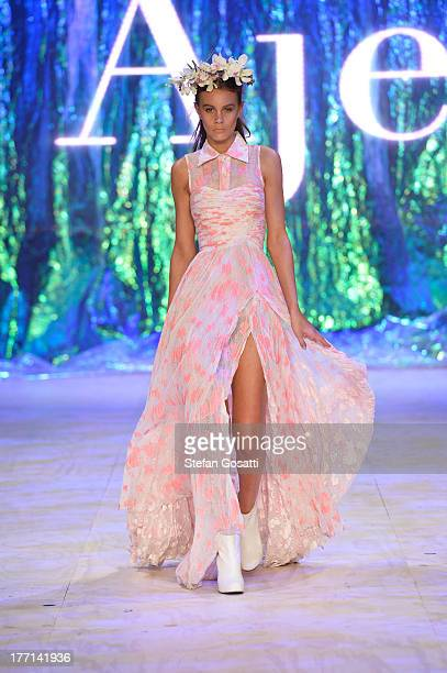 A model showcases designs by Aje on the runway at the MBFWA Trends show during MercedesBenz Fashion Festival Sydney 2013 at Sydney Town Hall on...