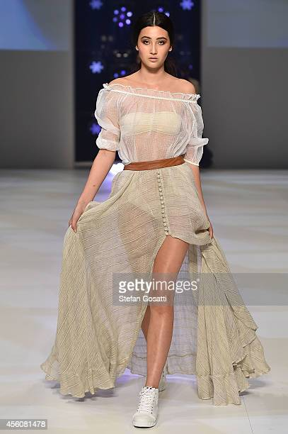 A model showcases designs by Aje on the runway during MB Presents Australian Style show during MercedesBenz Fashion Festival Sydney at Sydney Town...