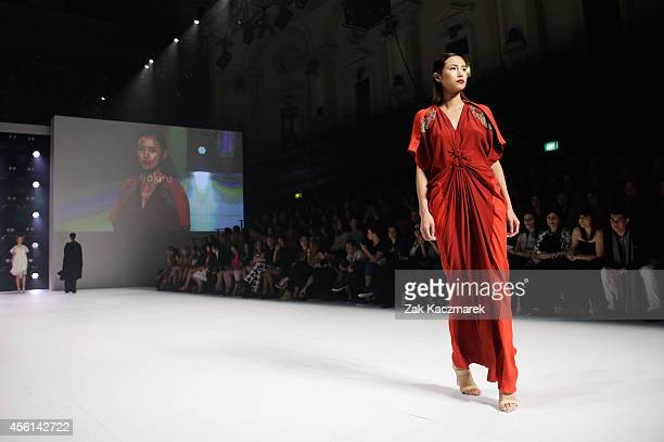 A model showcases designs by Akira at the Red Carpet runway show during MercedesBenz Fashion Festival Sydney at Sydney Town Hall on September 26 2014...