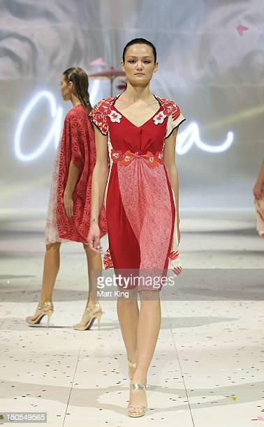A model showcases designs by Akira on the catwalk as part of Mercedes Benz Fashion Festival Sydney 2012 at Sydney Town Hall on August 21 2012 in...