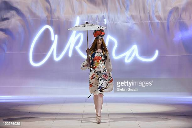 A model showcases designs by Akira on the catwalk as part of Mercedes Benz Fashion Festival Sydney 2012 at Sydney Town Hall on August 22 2012 in...