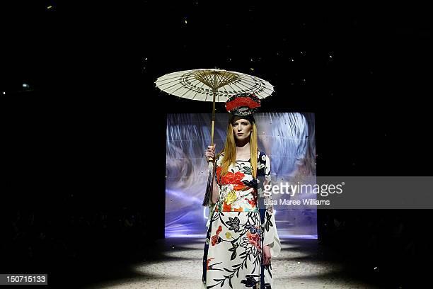 A model showcases designs by Akira on the catwalk as part of the MercedesBenz Fashion Festival Sydney 2012 on August 25 2012 in Sydney Australia