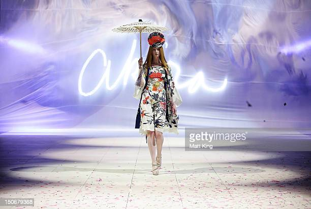 A model showcases designs by Akira on the catwalk during the Fashion Week Australia Review presented by Marie Claire as part of Mercedes Benz Fashion...