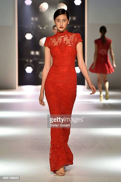 A model showcases designs by Alex Perry during the Red Carpet runway show at MercedesBenz Fashion Festival Sydney at Sydney Town Hall on September 26...