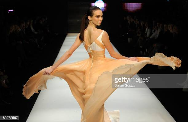 Model showcases designs by Alex Perry on the catwalk at the Fashion Targets Breast Cancer with Alex Perry and IMG Fashion gala event, celebrating 10...