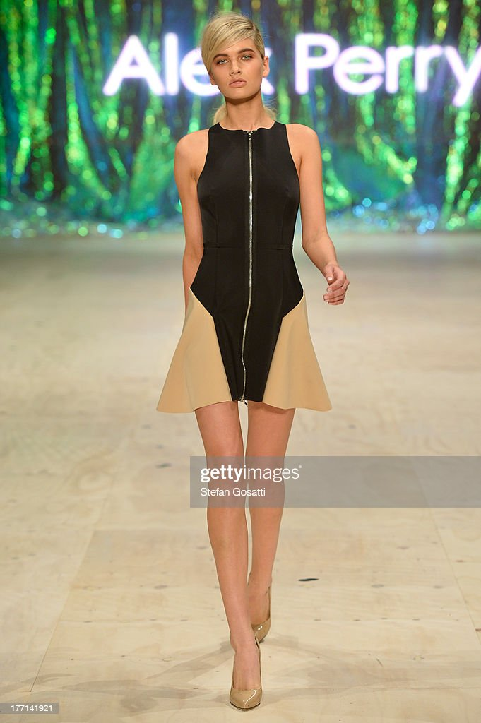 A model showcases designs by Alex Perry on the runway at the MBFWA Trends show during Mercedes-Benz Fashion Festival Sydney 2013 at Sydney Town Hall on August 21, 2013 in Sydney, Australia.