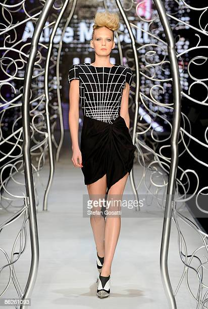 Model showcases designs by Alice McCall at the Diet Coca-Cola Little Black Dress Show on the catwalk at the Overseas Passenger Terminal, Circular...