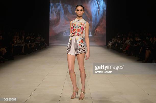 A model showcases designs by Alice McCall on the catwalk as part of Mercedes Benz Fashion Festival Sydney 2012 at Sydney Town Hall on August 23 2012...