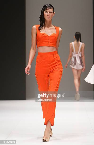 A model showcases designs by Alice McCall on the catwalk on day 6 of Melbourne Spring Fashion Week 2012 at Melbourne Town Hall on September 8 2012 in...