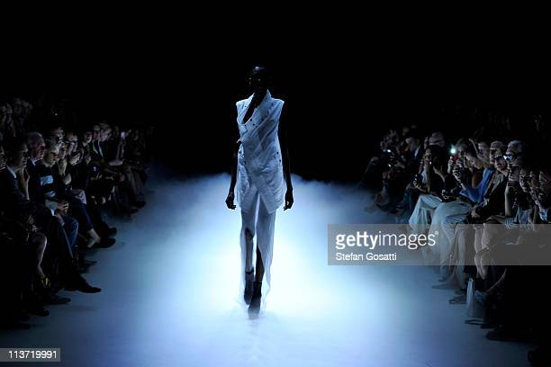 Model showcases designs by Alistair Trung on the catwalk during Rosemount Australian Fashion Week Spring/Summer 2011/12 at Overseas Passenger...