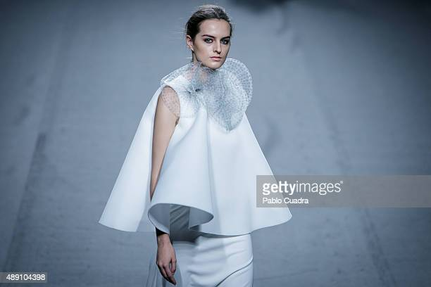 A model showcases designs by Amaya Arzuaga on the runway at the Amaya Arzuaga show during MercedesBenz Fashion Week Madrid Spring/Summer 2016 at...