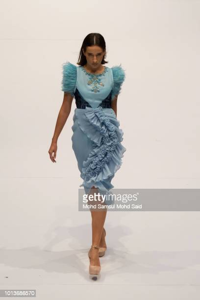 A model showcases designs by Amelia Hassan on the runway at the show during the Kuala Lumpur Fashion Week 2018 on August 9 2018 in Kuala Lumpur...