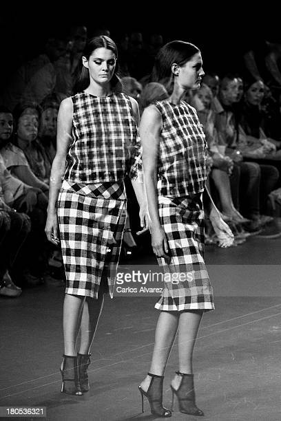 A model showcases designs by Angel Schlesser on the runway at Angel Schlesser show during Mercedes Benz Fashion Week Madrid Spring/Summer 2014 at...