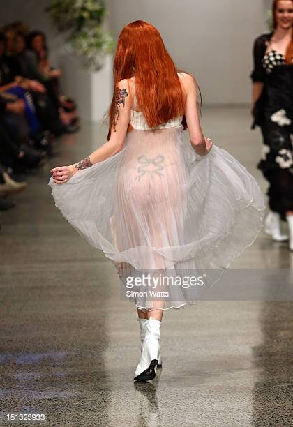 A model showcases designs by Annah Stretton at the New Zealand Fashion Week Autumn/Winter 2013 on September 6 2012 in Auckland New Zealand