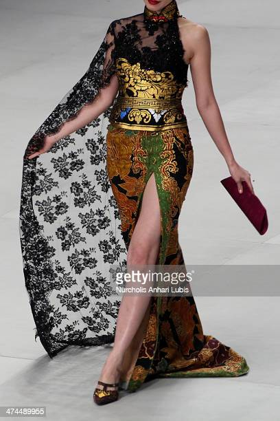 A model showcases designs by Anne Avantie on the runway during Indonesia Fashion Week 2014 day 4 at Jakarta Convention Center on February 23 2014 in...